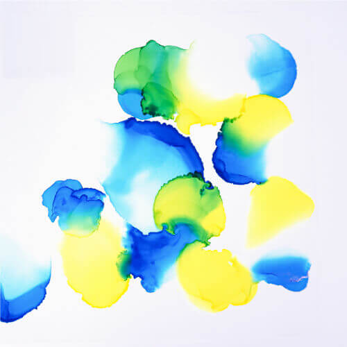 Alcohol ink can be revived even after it dries. To create an overlap between colors, apply a blending solution to create a transparent effect or another color on top of the dried ink to create a more vibrant effect.